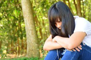 אישה בוכה מאובדן הורה